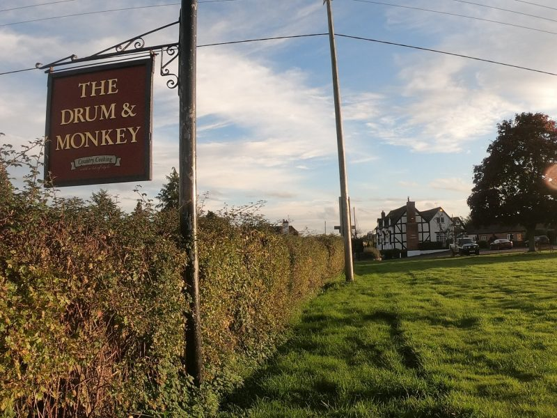 pitch at Drum and Monkey Pub campsite sign